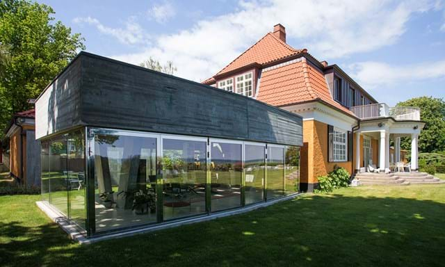 the pavilion at the swiss embassy designed by ladner meir architechten provides the setting. Black Bedroom Furniture Sets. Home Design Ideas